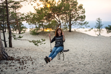 Girl swing on the beach Olkhon island