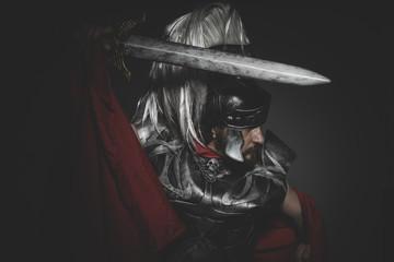 Praetorian Roman legionary and red cloak, armor and sword in war