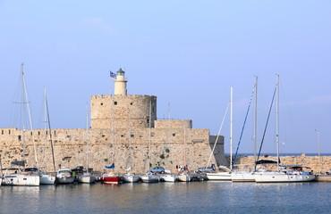 The Mandraki harbor in Rhodes town, Greece.