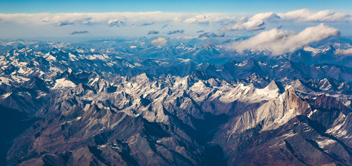 view from the aircraft to the mountains of the Himalaya