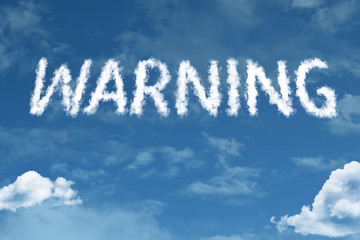 Warning cloud word with a blue sky
