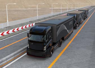 Fleet of autonomous hybrid trucks driving on highway. 3D rendering image.