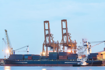 Industrial Container cargo ship with working crane bridge in the