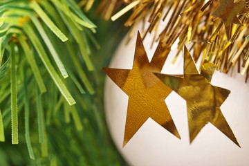 Chirstmas decoration detail with golden stars and ball