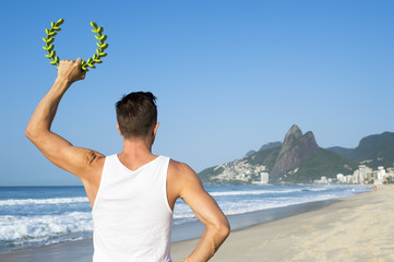 Athlete standing holding ceremonial laurel wreath in front of the Rio de Janeiro, Brazil skyline at Ipanema Beach