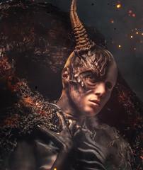 Portrait of devil woman with horn.