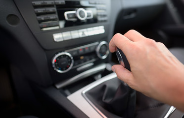 Driver shifting the gear stick