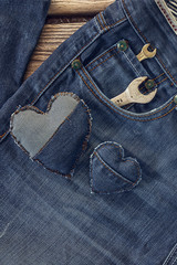 Wrench in the pocket of jeans. Happy fathers day concept.