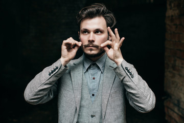 Portrait Elegant bearded vintage retro young handsome Businessman man hipster and He twists his mustache, Outdoor, jacket