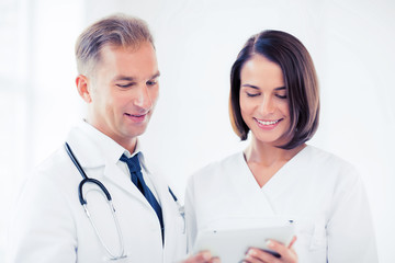 two doctors looking at tablet pc