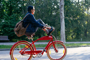 female riding vintage bicycle in park