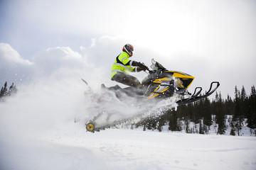 A person on a snowmobile, Sweden.