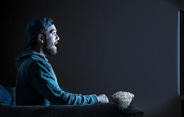 man in home cinema
