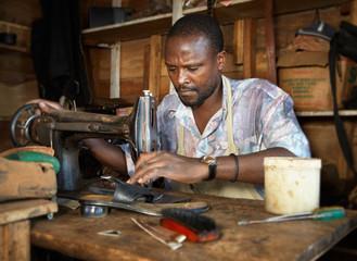 A shoemaker in Uganda.