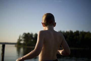 A boy bathing in the sea, Sweden.