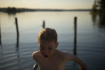 A boy bathing in the sea, Sweden.