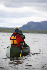 Canoeing in Lapland, Sweden.