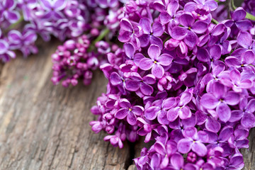 beautiful lilac on wooden surface