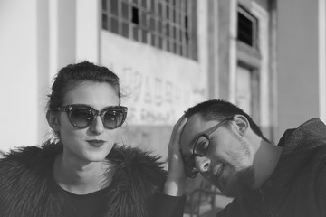 Black and white Portrait young woman ignoring her man partner wearing sunglasses bw photography