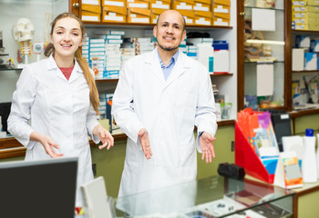 Two orthopedists working in special store with orthopaedic goods