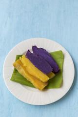 Purple and yellow sweet potato on banana leaf