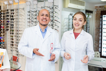 Opticians near stand with spectacles