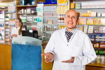 Smiling friendly glad pharmacist and pharmacy technician