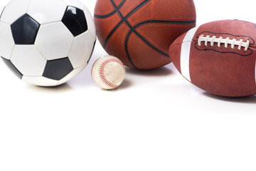 Assorted Sports Balls on white background - soccer, football, ba