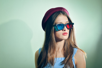 Surprised young pretty woman in 3d glasses looking amazed.