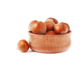 Hazelnut in a wooden bowl isolated on white background