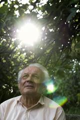 Portrait of a n elderly man under a tree, Croatia.