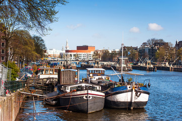 Moored boats at Amsterdam canal