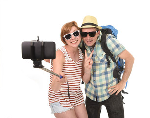 young attractive and chic American couple taking selfie photo with mobile phone isolated on white