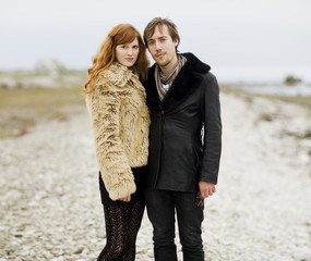 Portrait of couple posing for photograph