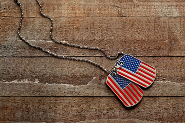 USA dog tags on wooden background