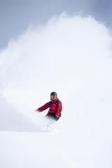 Snowboarder in powder snow.