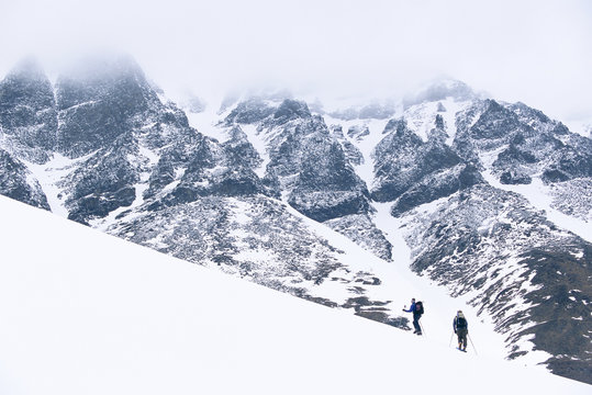 Two skiers climbing a mountain, Sweden.