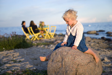 A girl sitting on a rock, Oland, Sweden.