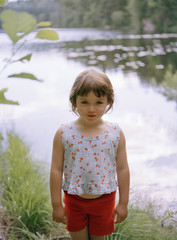Portrait of a girl standing by a lake, Sweden.