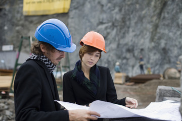 Project leaders at a building site, a man and a woman, Sweden.