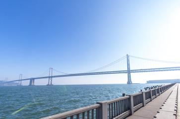 bay bridge over water in san francisco in blue sky