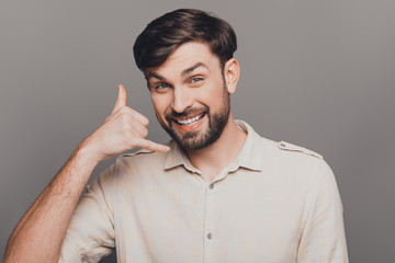 Cheerful happy bearded man gesturing and asking to call him