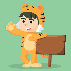 a child male in tiger costume with sign