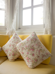 interior shot with pillow and window vintage style cottage house