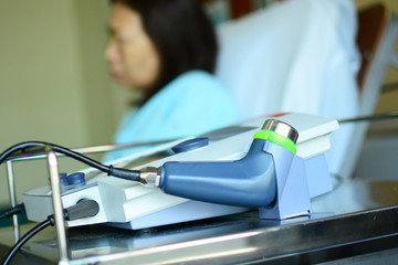 electric massage medical equipment with patient