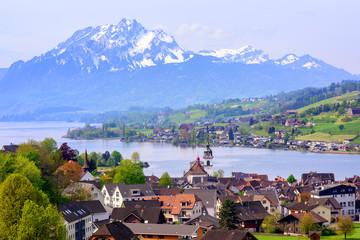 Little swiss town on Lake Lucerne and Pilatus mountain, Switzerland Wall mural