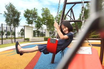Little girl on a swing