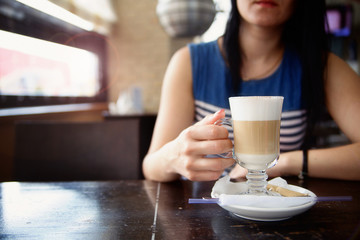 young woman drink coffee