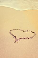 Love Heart drawn on sandy atlantic coast