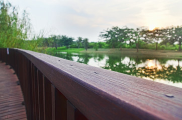 Wooden handrail of a viewing deck by the lake